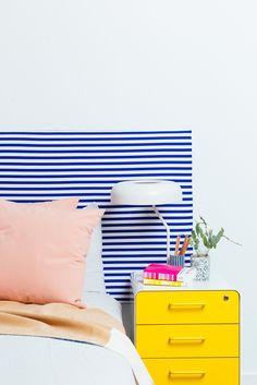 Looking to to spruce up your bedroom with a new headboard? Make your own with this amazing DIY that transforms a tabletop. For more Ikea hacks, head to Domino.com
