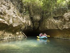 This group of adventure tourists is traversing through 4 caves by raft and kayak on Caves Branch River in Central Belize. It's another way to explore Belize.