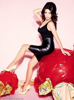 Sweet treat: Kim Kardashian shows off an item from the fifth Kardashian Kollection for Lipsy, on sale at various stockists from October 29, in a photo shoot by the iconic Ellen von Unwerth