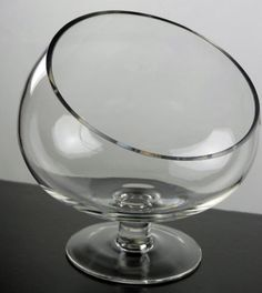"""This is the other style-- footed glass- can even do small versions of these or a big one like this. Clear Glass 9"""" Footed Bias Cut Glass Vase $18.99 each"""