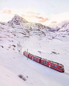 {   }  Morning glow and freezing wind at the Swiss/Italian border where the red Bernina Express starts its daily journey. #inspiring_engadinstmoritz  w/ @engadin.stmoritz by brahmino