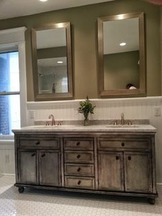 Bathroom Remodel: dual framed standalone mirrors; jack and jill sinks; distressed grey cabinets; light stone countertops