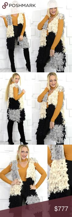 SASSY SHAG COLOR BLOCK VEST Brand new! Boutique item Price is firm  Looking for something, unique, fun and playful for your fall/winter wardrobe!? Grab this oh so soft and cozy knitted shag/ fringe open front vest featuring a fabulous color block print!! Pair with your favorite sweater/top and jeans or leggings for a complete look!  Material 50% acrylic 50% polyamide 1 hook closure I am Modeling in a size S/M, I usually wear a small. item is as seen in pics  sweate knitted cream black gray…