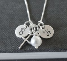 The cross from this necklace -   Hand Stamped Jewelry Personalized Mothers by TheSilverWren on Etsy, $36.00