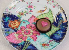 Valentine's Day is ...why not consider a set of Tobacco Leaf dessert plates? It's a heck of a lot more original than a box of chocolates. (But being the chocolate and porcelain lover that I am, I'd appreciate both!)