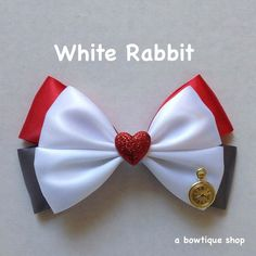 Up for your consideration is a custom made White Rabbit hair bow based on the classic story - Alice in Wonderland. The bow measures 5 inches Diy Ribbon, Ribbon Hair, Ribbon Crafts, Ribbon Flower, Hair Bow Tutorial, Flower Tutorial, Disney Hair Bows, Handmade Hair Bows, Diy Hair Accessories