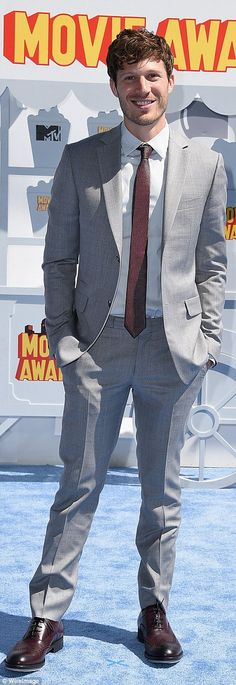 Styling: Friday Night Lights actor Zach Gilford looked sharp in a grey suit with maroon ti...