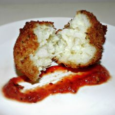 Italian Arancini (rice balls). Cooked white rice, grated Parmesan, eggs, shredded mozzarella, Italian-style bread crumbs, and oil for frying.