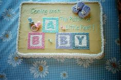 http://cakedecoratingcoursesonline.com/cake-decorating/ Baby shower cake with blocks and booties. Looking for Best #Baby Shower #Cake? - Learn Amazing #Cakes #Design Creating on http://CakeDecoratingCoursesOnline.com and Make Your Dream Baby Shower Cake Yourself