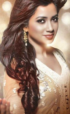 Shreya Ghoshal (born 12 March 1984) is an Indian playback singer who mainly sings in Hindi (715 songs), Kannada (215 songs), Telugu (195 songs), Tamil (127 songs), Bengali (120 songs), and Malayalam (47 songs) films as well as in other Indian languages such as Assamese, Gujarati, Marathi, Nepali, Oriya, and Punjabi.