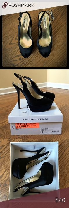 """EUC Steve Madden Laineyy satin platform pump Excellent condition, I wore these one time to a Christmas party! 5 1/2"""" heel, 1 1/4"""" platform. Size 6 but I'm a true 6.5 and they fit me fine being a sling back. Peep toe, adj buckle strap. Only sign of wear is on sole. Steve Madden Shoes Platforms"""
