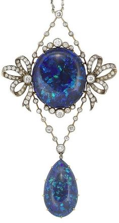 A belle époque black opal and diamond pendant necklace, circa 1905, The central oval black opal within a frame of millegrain-set old brilliant and single-cut diamond ribbon bows, supported by similarly-set diamond knife-edge bars, terminating in a pear-shaped black opal, on a trace-link chain, mounted in platinum and gold, diamonds approximately 1.70 carats total, detachable surmount, pendant length 8.6cm, chain length 39.0cm, fitted case by The Goldsmiths & Silversmiths Company LTD