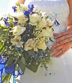 Here is a thought for you if you want to go with blue.  Have live white flowers and blue silk flowers as accents in the bouquet