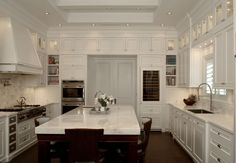 This sophisticated white kitchen was completed by RCS Wood Crafters. #luxeFL