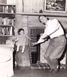 Gene Kelly and his baby daughter
