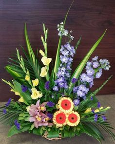 Summer beauty with delphinium, mini gerberas, gladiolus and orchids.