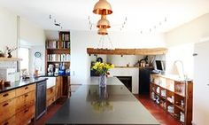The large kitchen features lots of reclaimed pine and sheets of stainless steel.