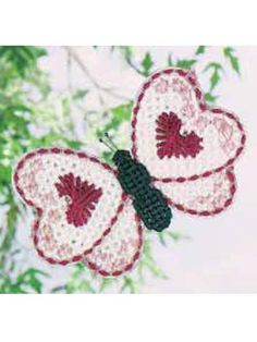 Plastic canvas...just think of all the great colors you could use!..free pattern