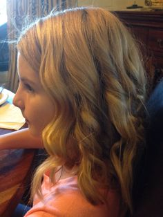 I did my Cousins hair, try doing short long curls by the face and curl layers one by one in back