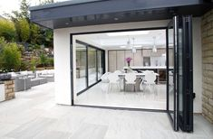 Offering Premium Performance & Flawless Style, is the Perfect Bi-fold Door for Family Homes & Bi-folding Patio Doors. Bi Folding Doors Kitchen, Folding Patio Doors, Bifold Doors Onto Patio, Express Bi Folding Doors, Bi Fold Doors, External Sliding Doors, Kitchen Orangery, Outdoor Garden Rooms, Kitchen Layout Plans