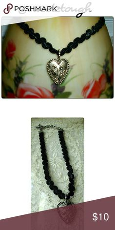 """VINTAGE HEART CHOKER! Beautiful hand poured silver pendant with ruffle weave nylon choker. Pendant is hand poured steel with beautiful flower molded into it. Very adjustable. Back has an adjustable chain made of nickel free and lead free steel. Closure is a sturdy lobster clasp! EUC! Length is 14""""-17"""" Jewelry Necklaces"""