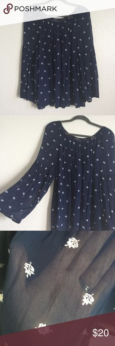 • lucky brand blouse • Blue and white transparent. Has long bell sleeves. Defects pictured. Not very noticeable unless you're inches away from the shirt. In good used condition. Length of the shirt is 26 inches. Bust measures 23 inches. All measurements done while flat laid. Lucky Brand Tops Blouses