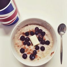 I desperately need to go grocery shopping! Only fruit left is frozen #blueberries. Anyway, this morning's #breakfast was egg white #oatmeal topped with the blueberries and a Belgium white #chocolate square. #food #foodie #instafood #igfood #igfitness #iifym #iifymgirls #fitfam #fitspo #fitfood #fitness #fitgirls #flexibledieting #healthy #healthyfoodporn #oats #porridge #proats #Padgram