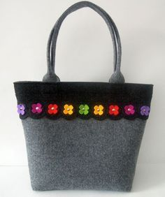 Beautiful and elegant handmade handbag made from strong thick felt with rainbow flowers.