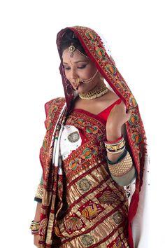 Traditional white and red color saree with beautiful bandhani patterns and heavy border with embroidery. Rich zari checks pallu and traditional small bandhej patterns. For more details call/whatsapp - 91-9377399299  #sankalpthebandhejshoppe #panetar #bandhani #tiendye #wedding #diwali #vadodara #ahmedabad #anand #designersaree