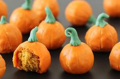 These sweet little Pumpkin Donut Holes look and taste like pumpkins. Each crispy pumpkin spice doughnut is coated in a yummy pumpkin spice glaze and is decorated with a candy stem.