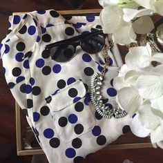 Black and Blue Polka Dot Blouse White with black and cobalt blue polka dots; 3/4 button sleeve, pocket front, size small. Great condition! New York & Company Tops Blouses