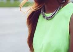 Bold statement necklace with a silk neon tank- cool chic. <3 www.sincerelyjules.com via @Sincerely Jules