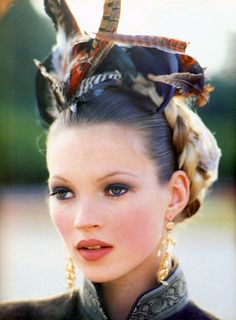 because Kate Moss unperfect features are what makes her beautiful, a real standout. stunning.
