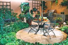This is what I want our side yard seating area to look like .... love how the barbeque is a part of it