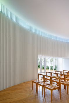 """Japanese studio Kubo Tsushima Architects has renovated a wedding chapel in Tokyo's Ebisu district – painting each windowsill in colours of the rainbow to """"impart faint hues"""" as light filters through"""