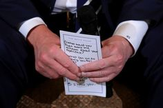 President Donald Trump holds his notes while hosting a listening session with student survivors of mass shootings. (Chip Somodevilla via Getty Images)