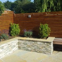 Our stone cladding walls replicate natural stones to give your garden walls the look and feel of natural stone. Backyard Patio Designs, Backyard Fences, Garden Fencing, Natural Stone Cladding, Contemporary Garden Design, Back Garden Design, Outdoor Walls, Outdoor Rooms, Stone Planters