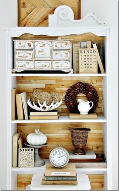 Rustic Wood Bookcase --- Simply cut and glue wood shims to the back of a bookcase