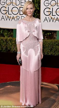 Show-stopping: Cate opted for simple accessories, allowing the dress to command full attention on the red carpet