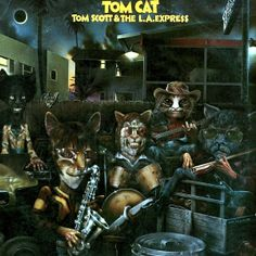 What a cool album cover from 1974 Tom Scott and the LA Express TOM CAT  Robin Ford plays guitar on this album. f47f9db4dc9f