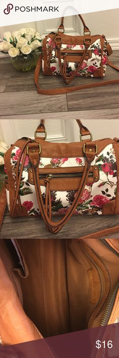 Aldo Cross body Floral Satchel Gorgeous floral speedy bag. Comes with adjustable  cross body strap and two handles. Front zipper compartment and inside pockets.  Tassel details on each zipper. Excellent condition 10 inches height, 4 inches wide 12 inches length. Aldo Bags Satchels