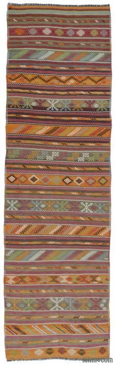 Vintage kilim runner rug around 60 years old and in very good condition. This rug which was embroidered with small jijim weavings was hand-woven in the Sivas region of Central Anatolia, Turkey.