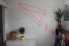 Pink 3D triangles