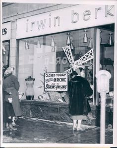 Sign in the window at 2521 W Devon announcing the store closed due to the staff going on a picnic because of Stalin's death, 1953, Chicago.