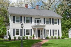 The gorgeous Georgian colonial four-bed, four-bath home boasts exquisite detail in its tall baseboards, crown molding, many French doors, custom hardware and wall-to-wall wainscoting.
