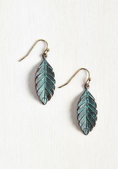 Feather Figure Earrings. Put your trust in these antiqued feather earrings, for theyll bring carefree charm to every look! #blue #modcloth
