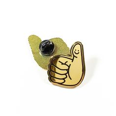 """Super shiny and positive like getting a thumbs up of approval! A throwback to drawing on your fingertips as a kid :) - 1.25"""" hard enamel pin - Cloisonné finish for a sleek, jewelry-like appearance - H"""