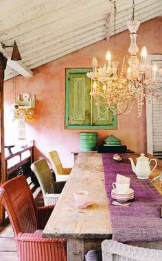 love the mix of rustic (table, wall, shutters)  with elegant (chandelier). needs different chairs, though