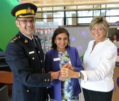 Surrey RCMP Inspector Dave Attfield, VanCity Newton Community Branch Manager Rup Sumal, and City of Surrey Councillor Mary Martin. The purple bracelets were handcrafted by the Sambhali Trust <3
