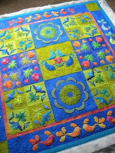 Jenny's Doodling Needle, awesome quilting.  Love the quilt colors and design.
